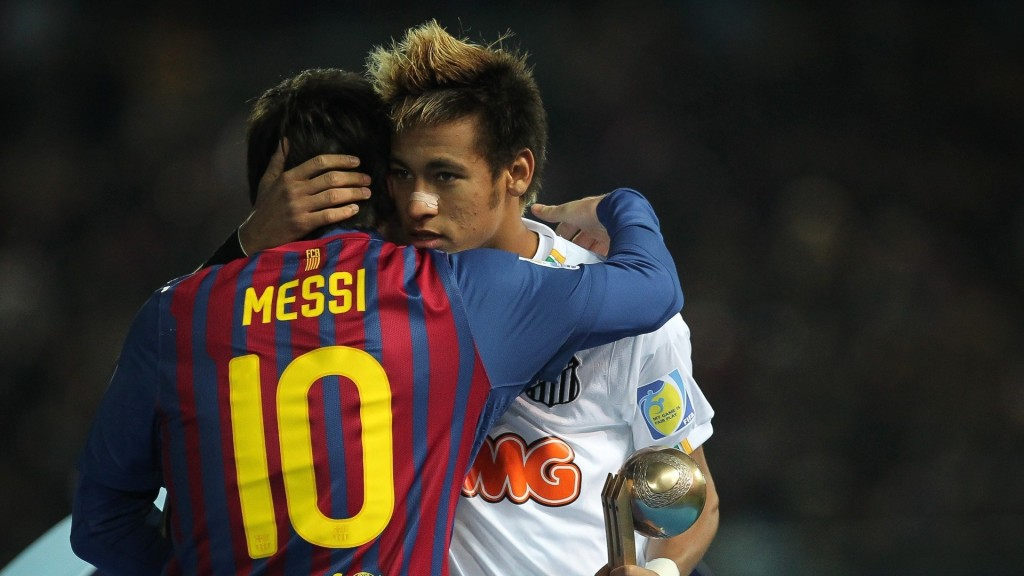 Neymar and Lionel Messi hugging each other