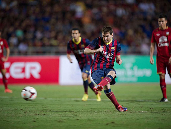 Lionel Messi scoring a goal for Barcelona