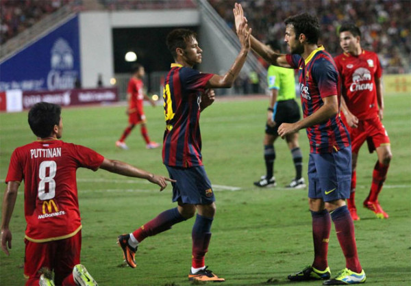 Neymar celebrating his first goal for Barcelona, with Fabregas