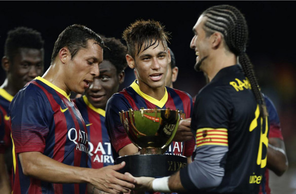 Neymar holding his first trophy at Barcelona, in 2013