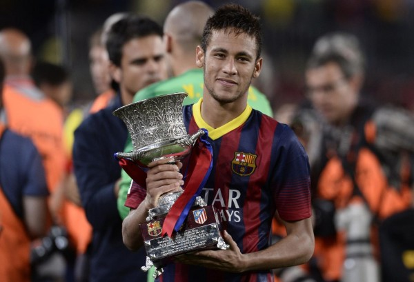 Neymar holding his first trophy won at Barcelona, in 2013