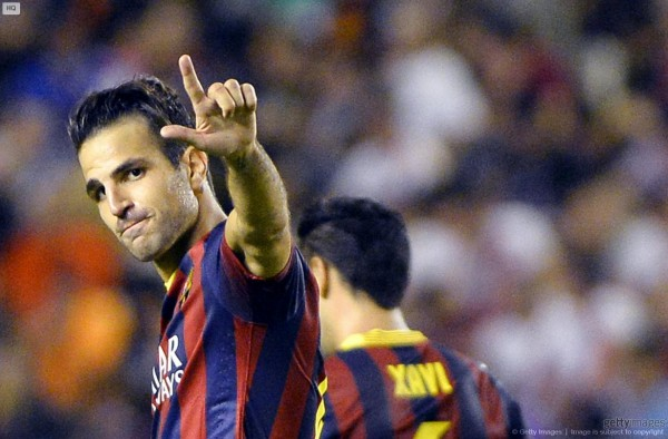 Cesc Fabregas making a curious hand gesture, after scoring for Barcelona