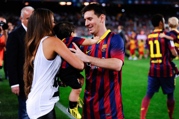 Lionel Messi and his girlfriend Antonella Roccuzzo, holding their son at the Camp Nou