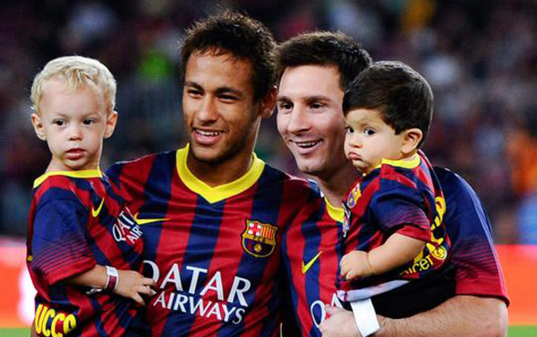 Lionel Messi and Neymar holding their own sons at the Camp Nou