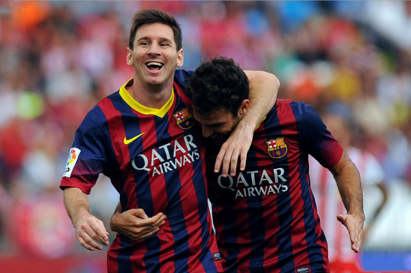 Lionel Messi big smile and hug to Cesc Fabregas, in Almeria 0-1 Barcelona