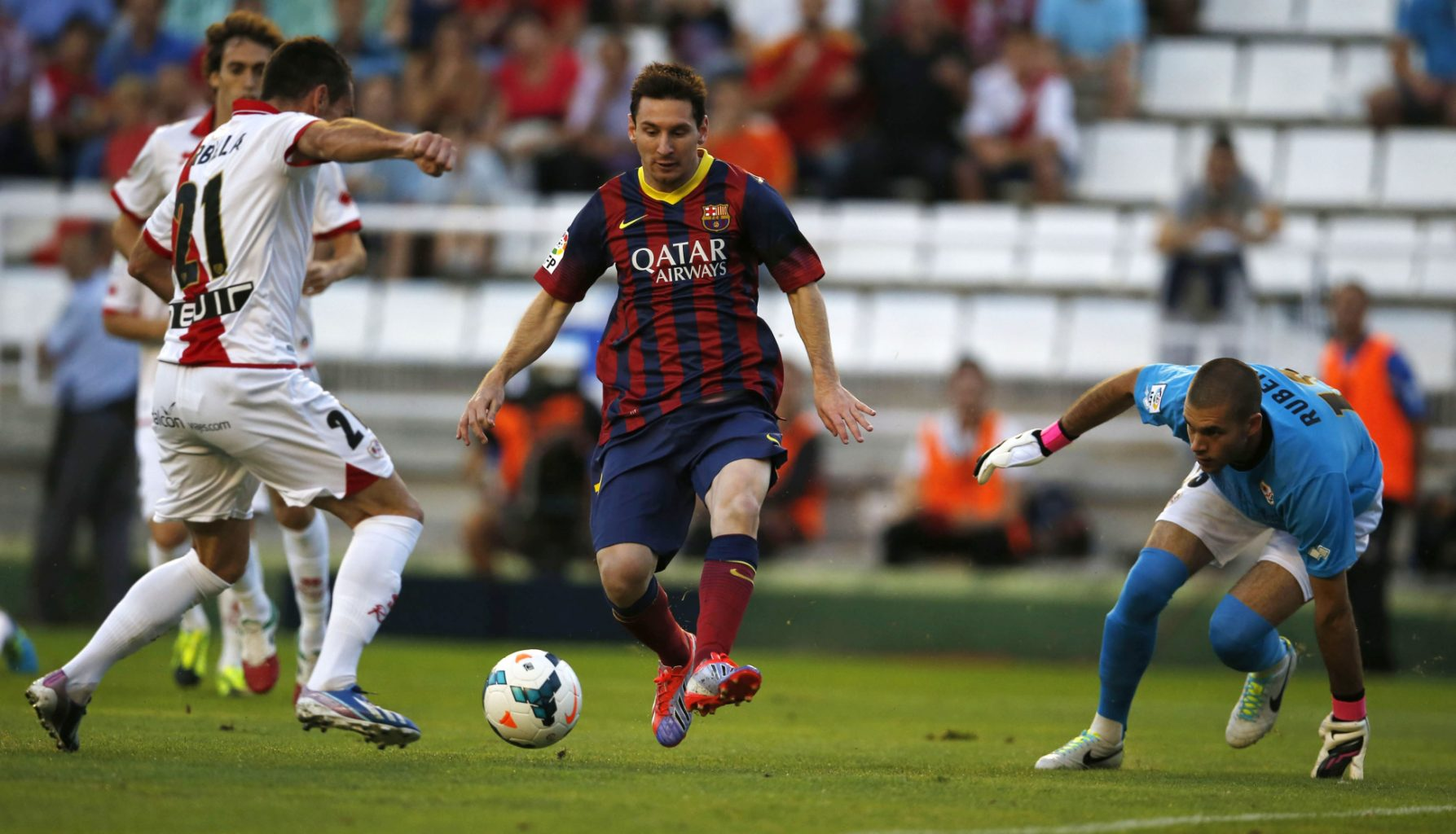 Lionel Messi surrounded by Rayo defenders
