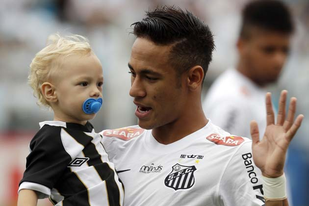 Neymar and his son David Lucca, ahead of a Santos game