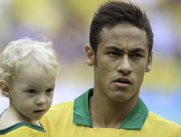 Neymar and his son David Lucca on the pitch, ahead of a Brazil international match