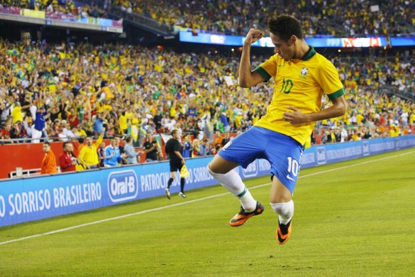 Neymar jumping to celebrate his goal for Brazil against Portugal, in 2013
