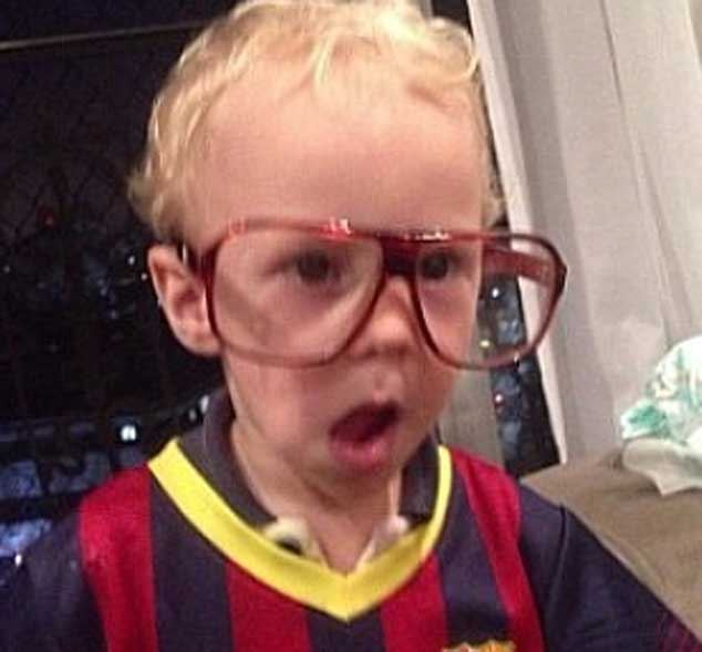 Neymar son David Lucca wearing a Barcelona jersey