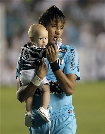 Neymar taking his son to the pitch, in Brazil