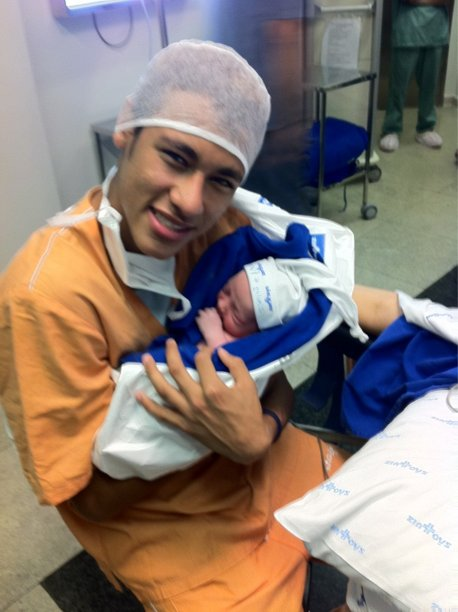 Neymar with his baby son David Lucca da Silva Santos, at the hospital