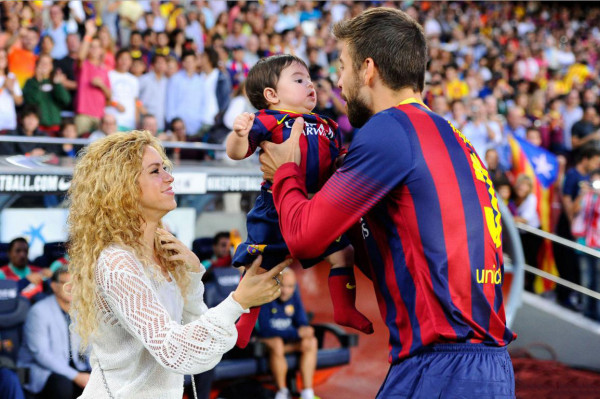 Shakira and Gerard Piqué, taking their son and daughter Milan, to a Barcelona game in 2013