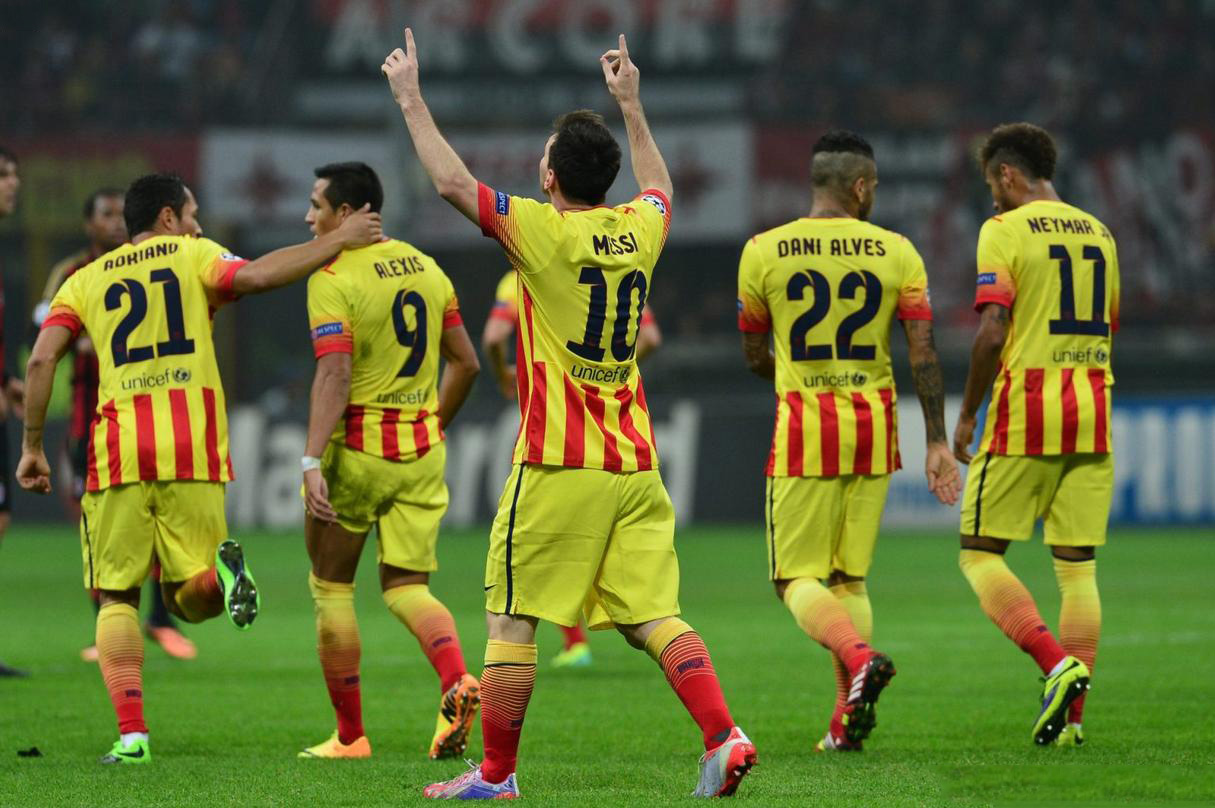 Barcelona players wearing the new away Barcelona jersey 2013-2014, in yellow and red stripes