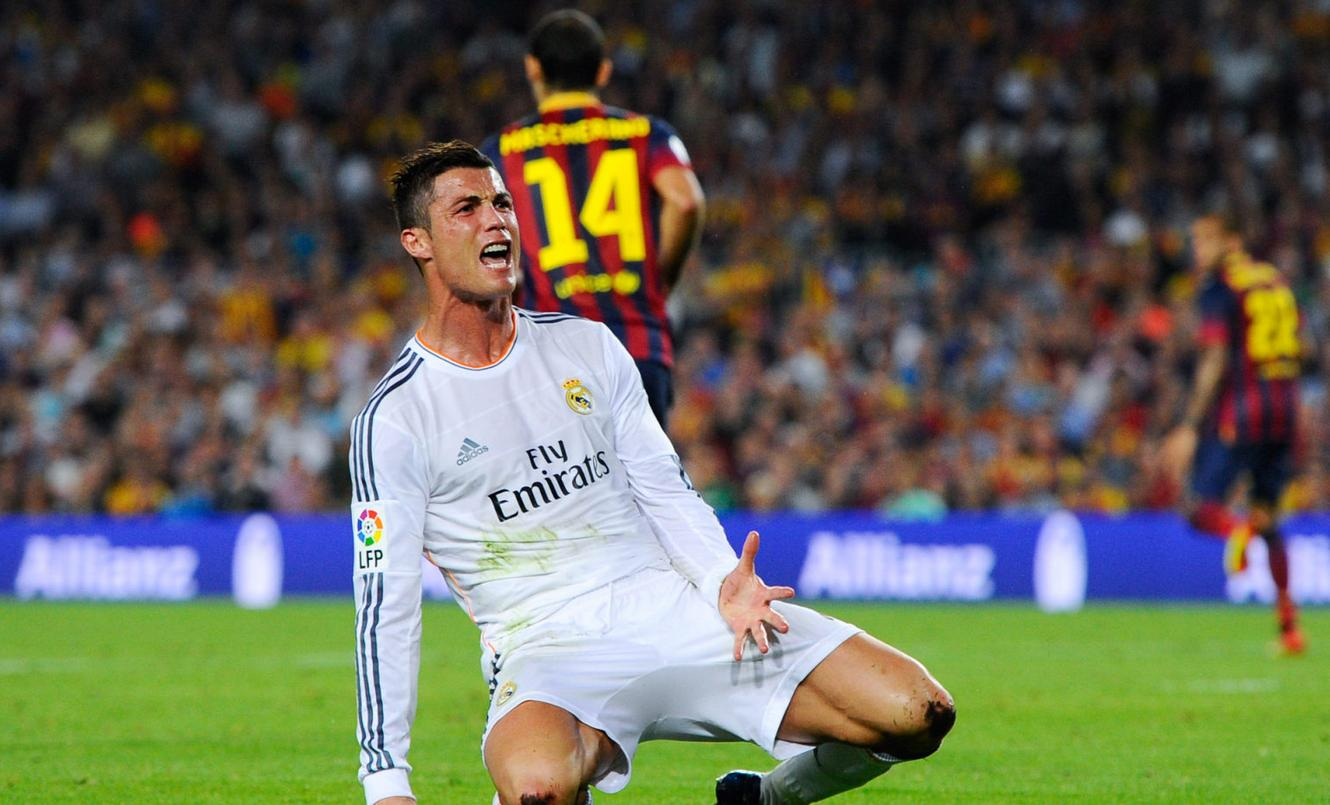 Cristiano Ronaldo on his knees at the Clasico Barcelona vs Real Madrid