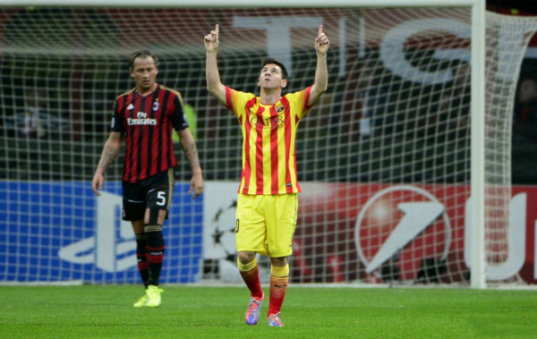 Lionel Messi pointing to the sky, as he celebrates Barcelona goal against Milan