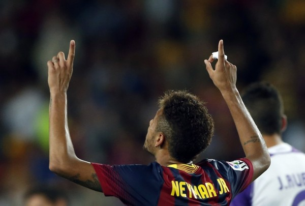 Neymar thanking God after scoring a goal for Barcelona