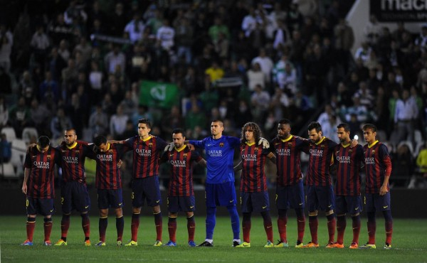 Barcelona team respecting one minute of silence