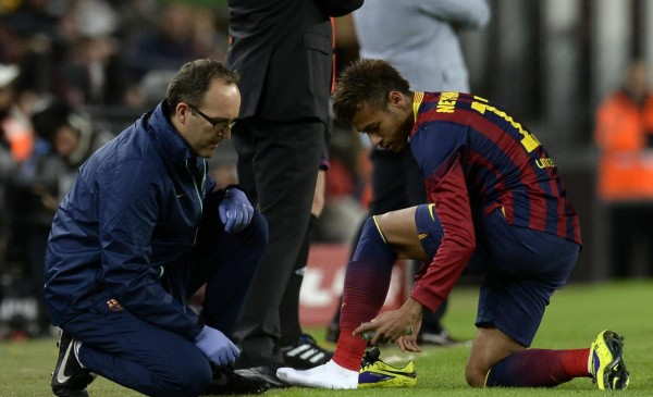 Neymar changing his football boots in Barcelona