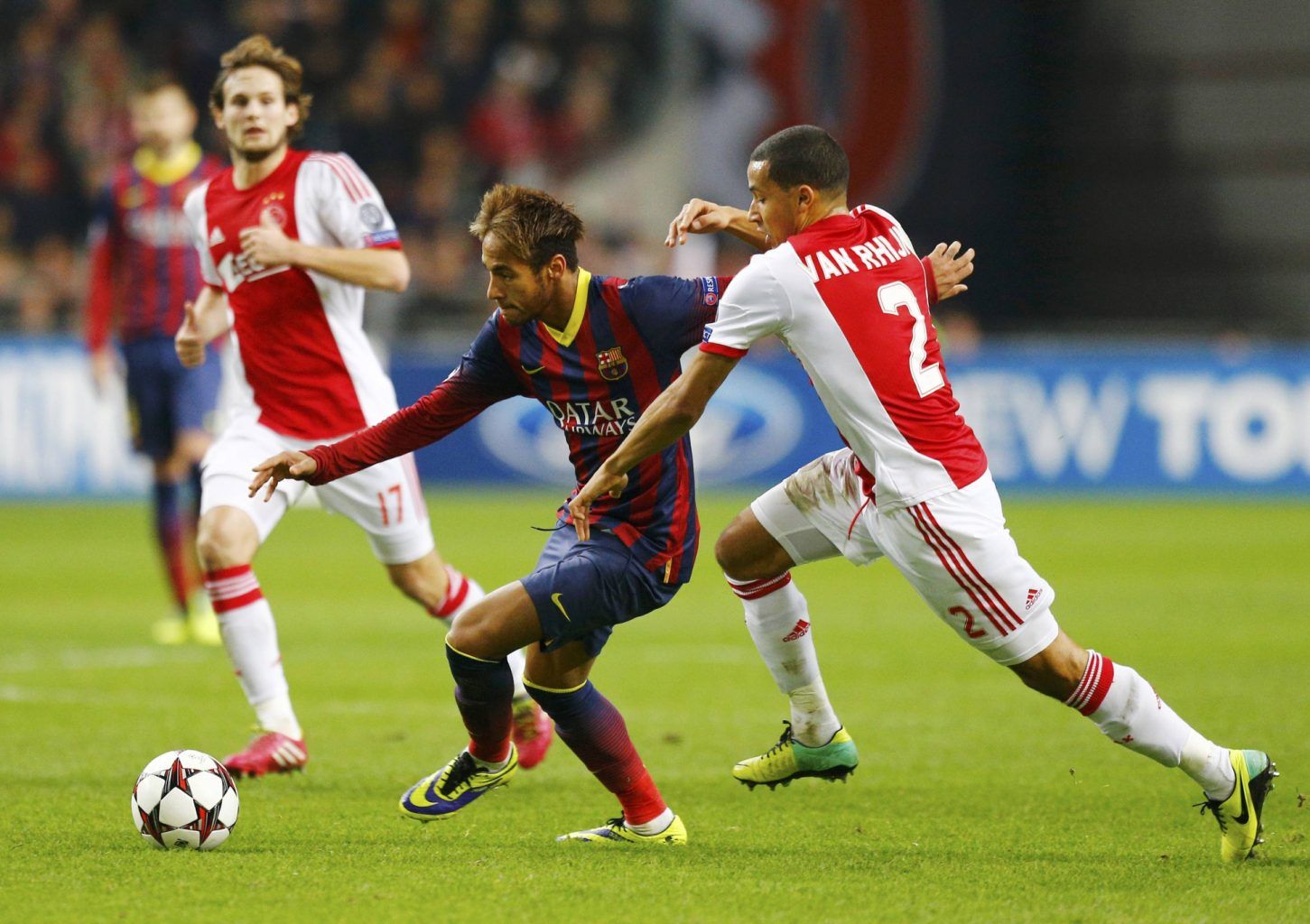 Neymar escaping the marking of an Ajax defender