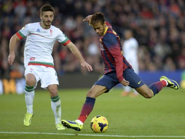 Neymar preparing to strike the ball with his left foot