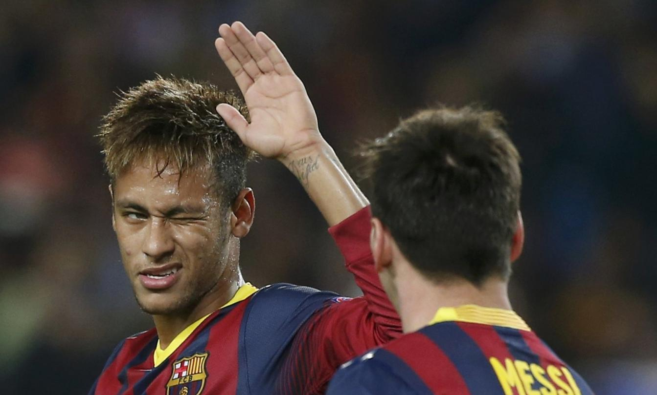 Neymar winking at Lionel Messi