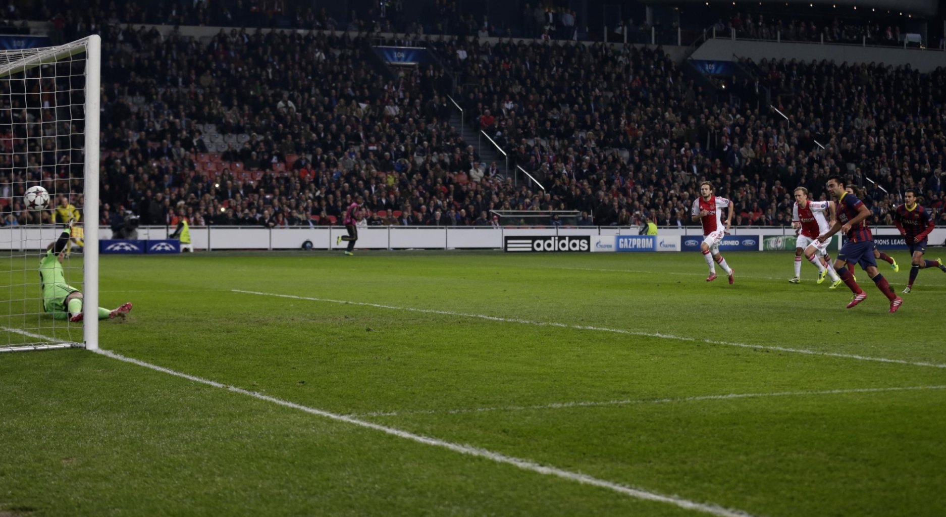 Xavi scoring for Barcelona, in the Champions League, from the penalty-kick spot