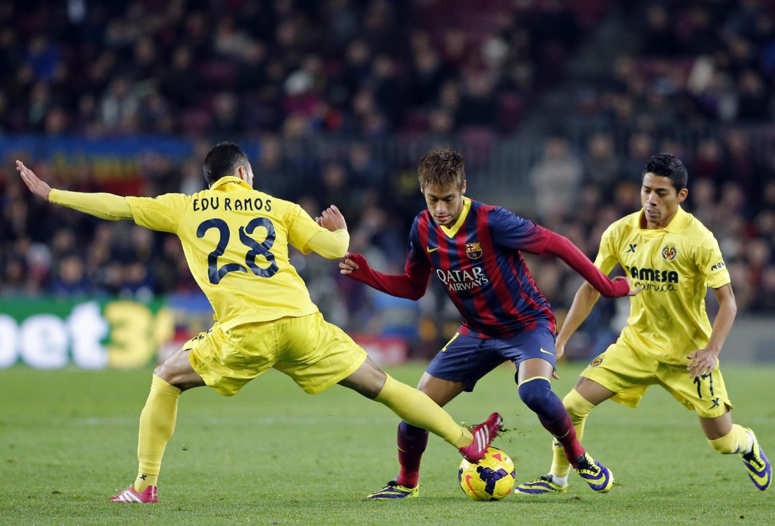 Neymar getting past two Villarreal defenders