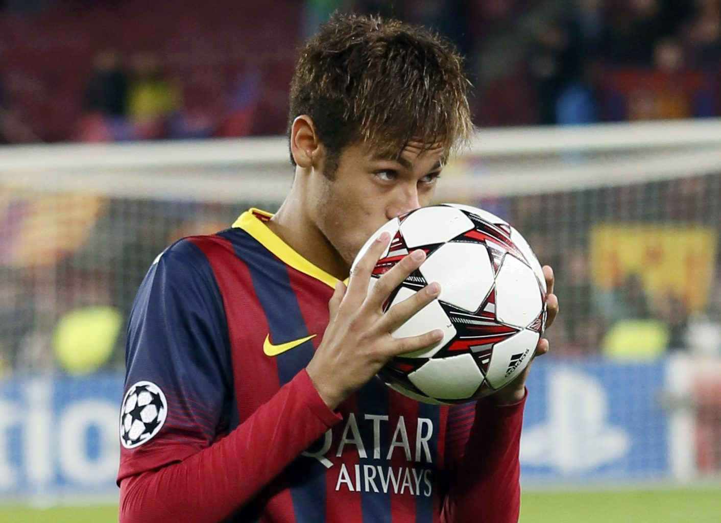 Neymar kissing the hat-trick game ball