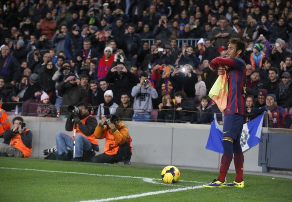 Neymar playing with the corner kick flag