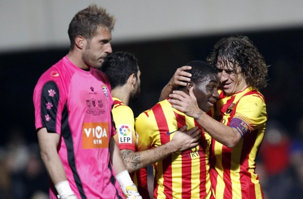 Puyol congratulating Dongou for his first goal for Barcelona