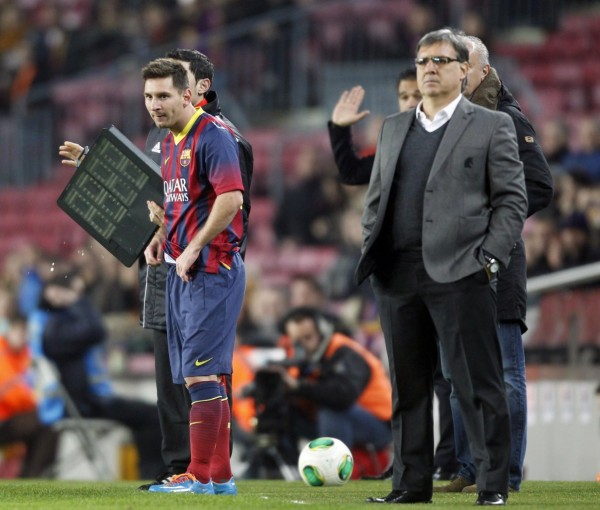 Lionel Messi about to come in, on his return after injury