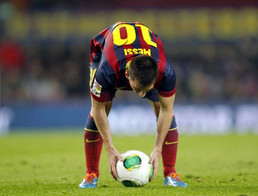 Lionel Messi preparing to take a free-kick for Barcelona