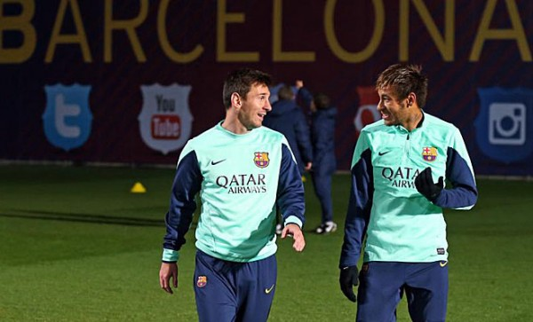 Messi and Neymar talking to each other, at a training session