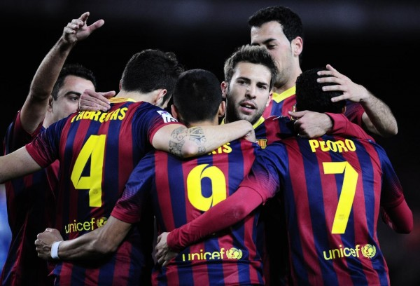 Barcelona team players gathering to celebrate goal