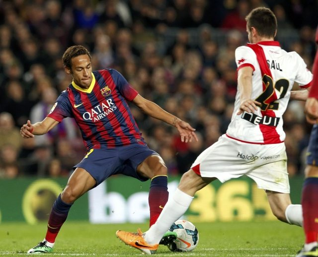 Neymar dribbling in a Barcelona game