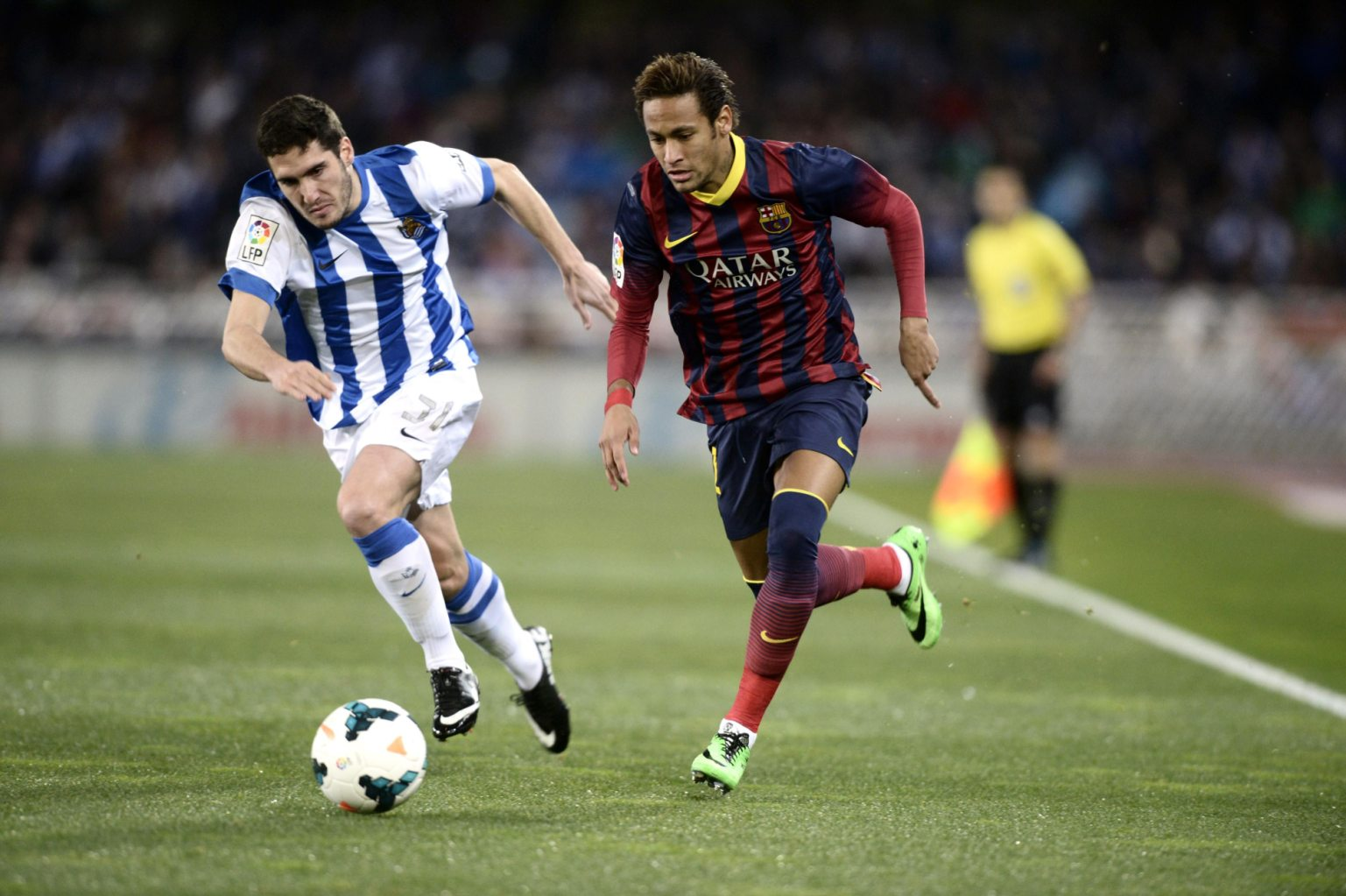 Neymar running past a defender