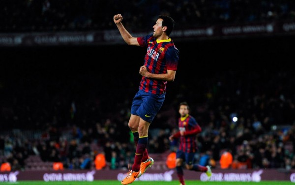 Sergio Busquets jumping to celebrate his goal for Barcelona