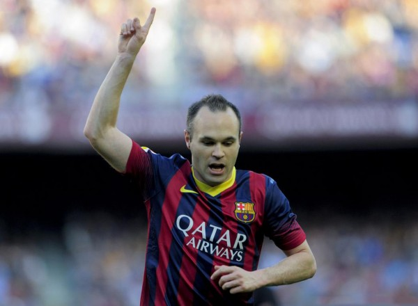 Andrés Iniesta raising his finger to the sky to dedicate his goal to his decesead son