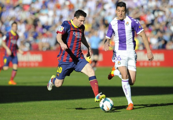 Lionel Messi racing with the ball