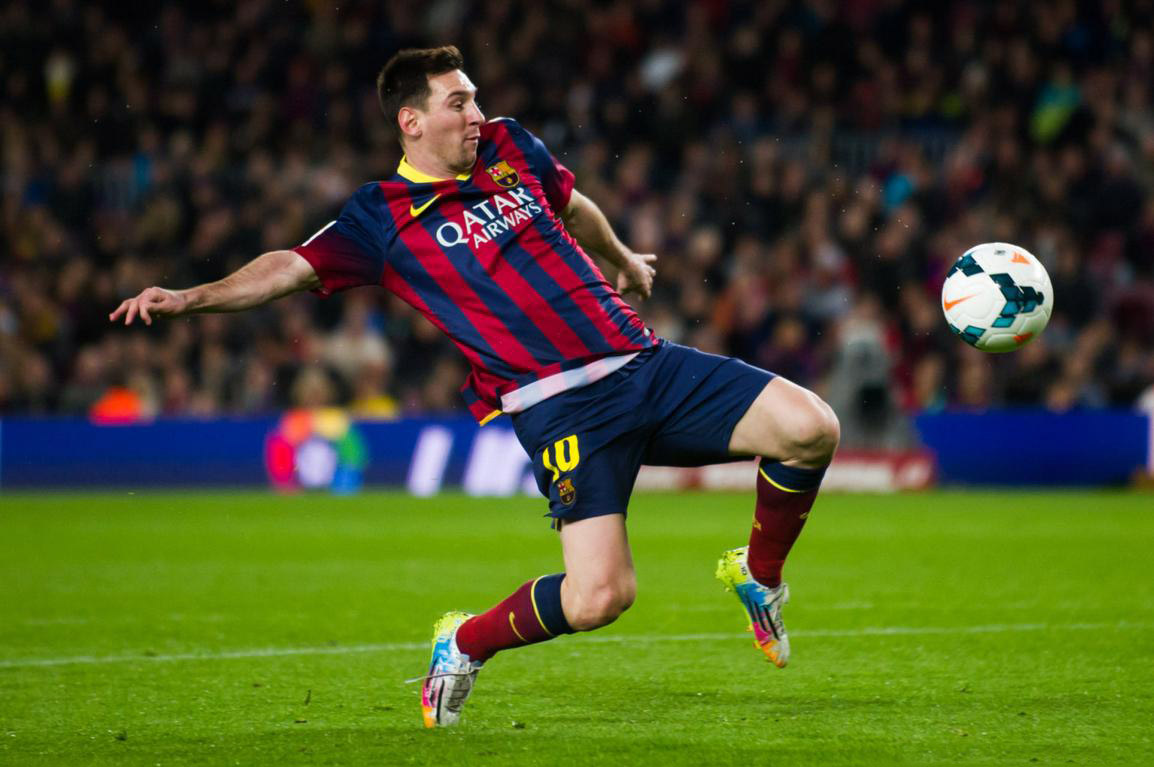 Lionel Messi reaching to the ball