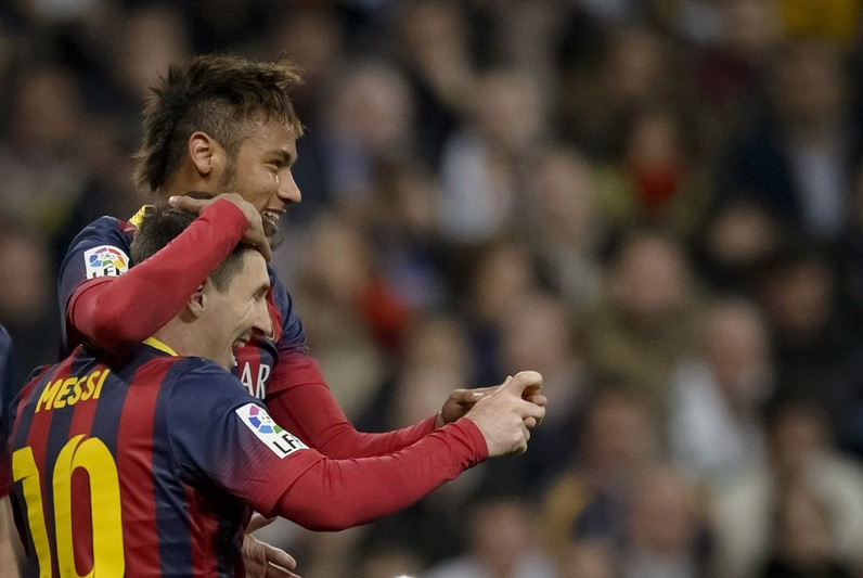 Neymar and Lionel Messi celebrating win over Real Madrid in Clasico