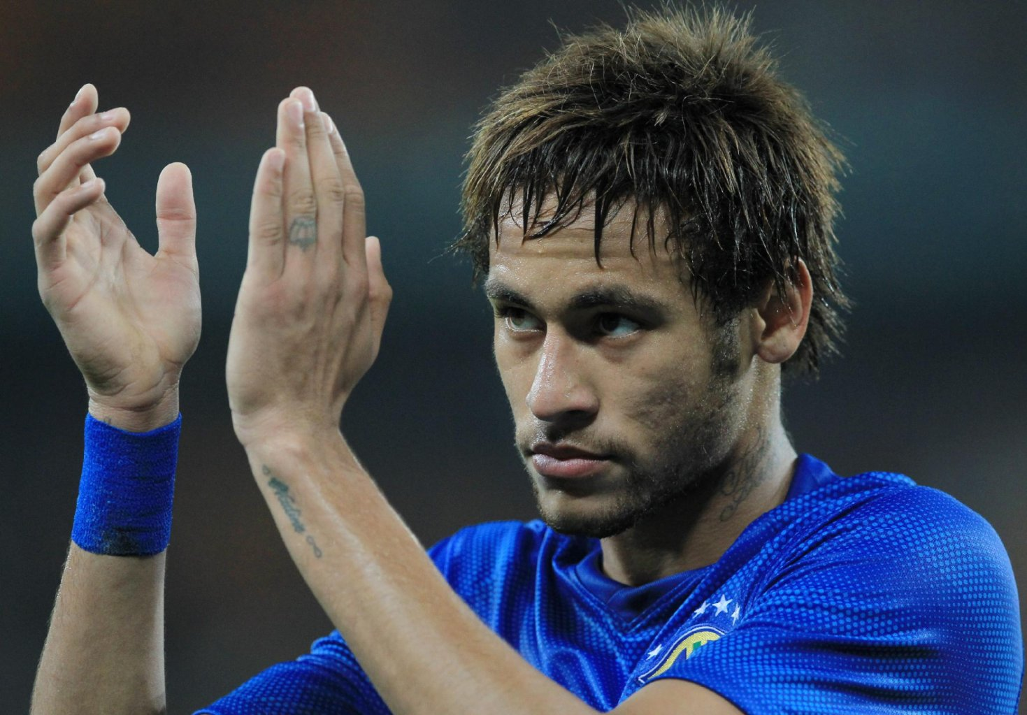 Neymar clapping his hands in a Brazil blue jersey