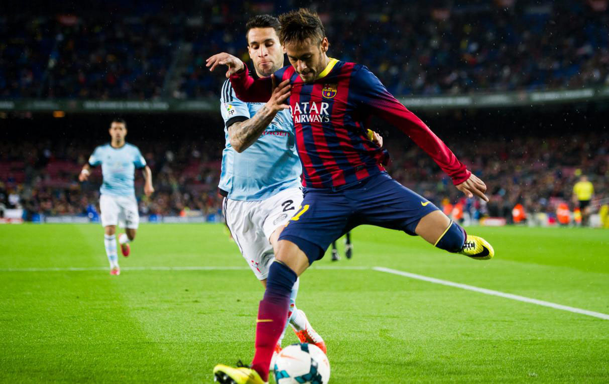 Neymar getting in front of a defender