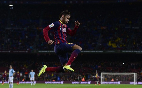 Neymar jumping in a Barcelona game