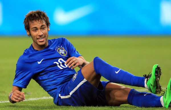 Neymar lying on the ground in a Brazil match