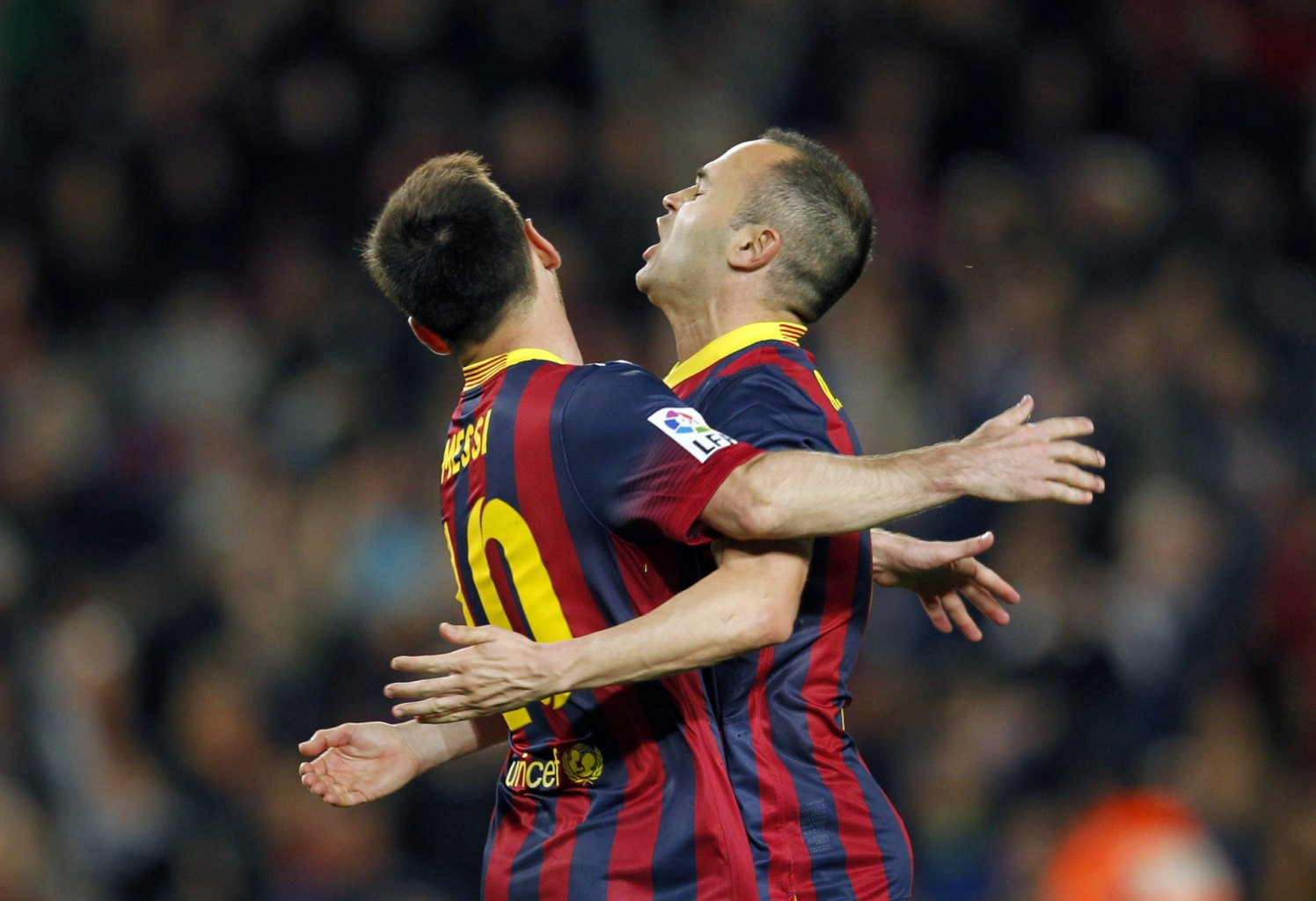 Lionel Messi and Andrés Iniesta clashing their chests