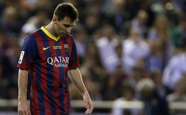 Lionel Messi with his head down