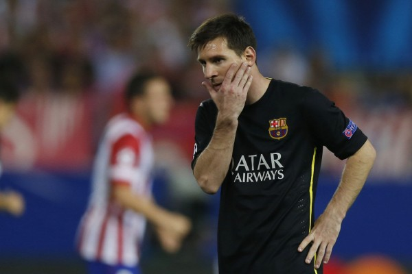 Lionel Messi putting his hand on his face