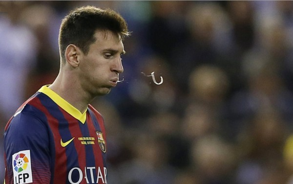 Lionel Messi spitting